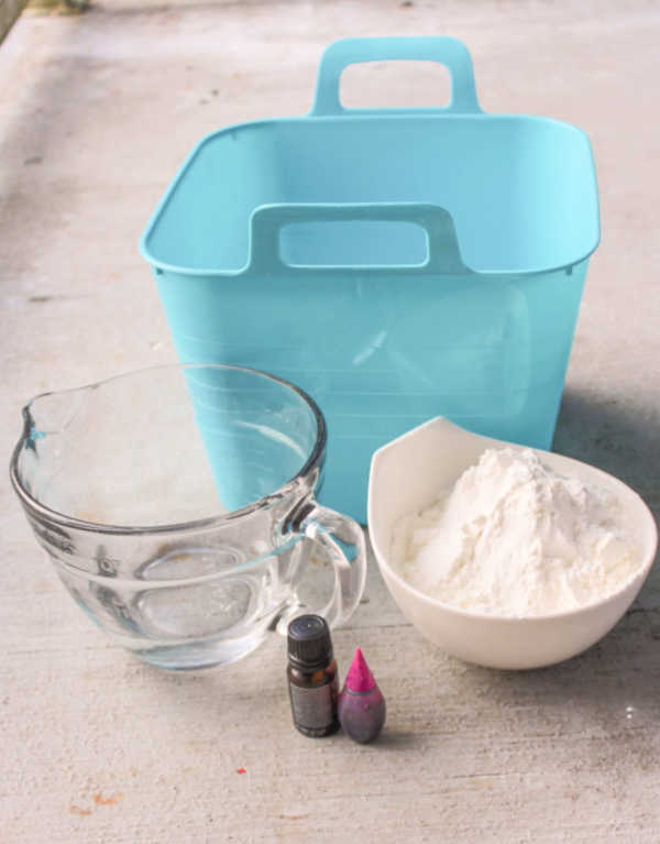 Lavender oobleck recipe. What you need is a bin, cornstarch (corn flour), essential oil, water and food colouring